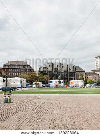 STRASBOURG FRANCE - MAY 18 2016: Vertical view of FFF Tour Federation Francaise de Football installation in city center for the upcoming UEFA football soccer Championship with General Kleber Statue