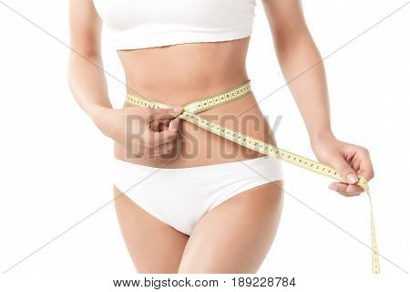 Cropped View Of Woman With Perfect Slim Body Measuring Her Waistline Isolated On White