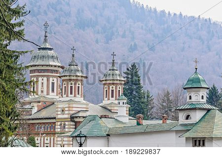 The Orthodox Monastery Sinaia With Towers And Crosses On Top, Outdoor Details Close Up