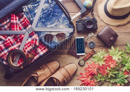 passport luggage Wallets goggles smartphone accessories On wooden floor with travel in the spring.
