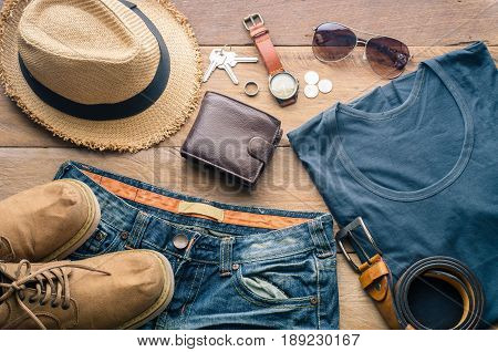 Accessories and apparel for travel on a wooden floor - life style