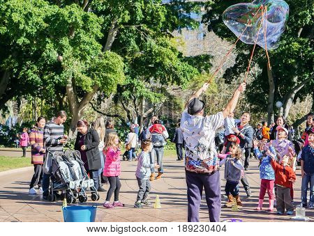 family activities in Hyde Park on weekend taken in Sydney Australia on 4 July 2016
