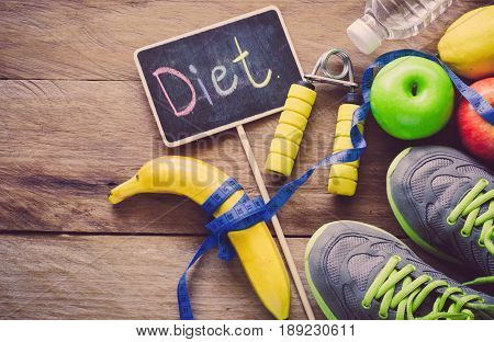 The concept of diet for weight loss - Exercise Equipment and word