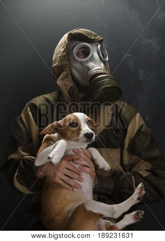 the photo of man in gas mask on grey background