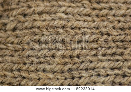 knitted cloth a front smooth surface from yarn for knitting of beige color a background