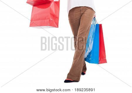 Waist Down View Of Woman Carrying Shopping Bags