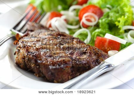 Steak with herbs and vegetable salad