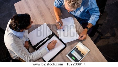 Digital composite of Business people discussing by signup screen on tablet PC