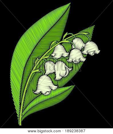 Embroidery lily of the valley isolated on black background.