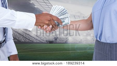 Digital composite of Business people exchanging money at stadium
