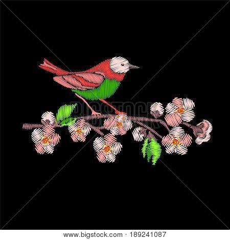 Embroidery Japanese Robin bird and tree branch isolated on black background. Sakura blossom flowers.