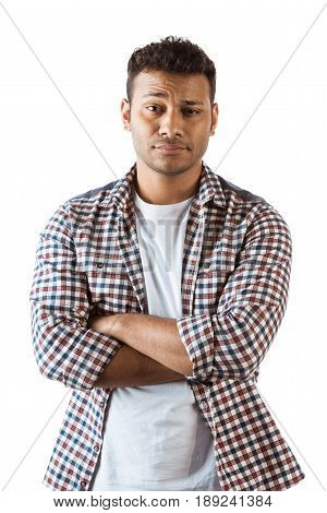 Portrait Of Skeptic Man With Arms Crossed Looking At Camera Isolated On White