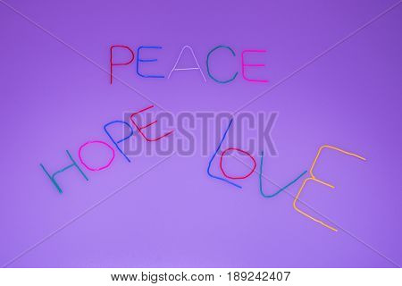 Hand made message - peace hope love made from thin wire