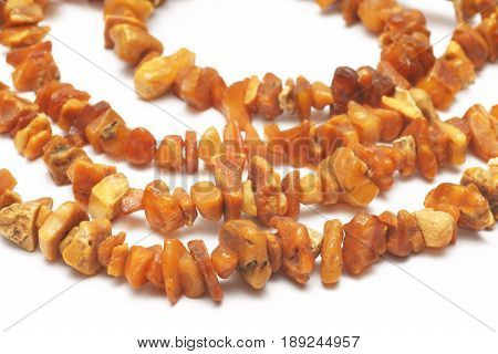 Amber necklace natural and untreated on a white background