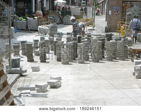 Alora Spain - April 26 2017: Square paving stones stacked for laying in village street in Andalusia