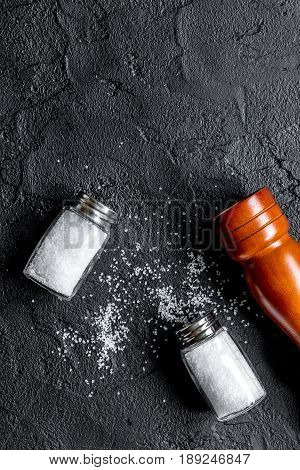 Salt And Saltcellar On Black Stone Table Background Top View Mock-up
