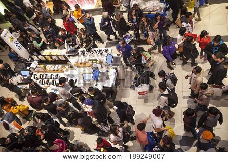 TORONTO, CANADA. December 26, 2014: Interior of a shopping center in Toronto, Canada. During the Christmas season. A crowd of people through the corridors of the mall to complete purchases.