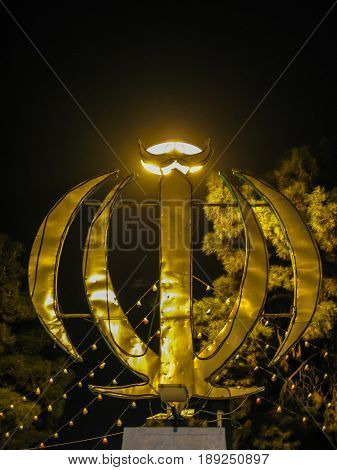 Night view Monument emblem of Iran, word Allah, Yazd Iran