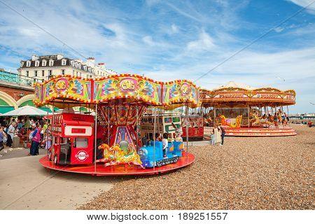 BRIGHTON EAST SUSSEX ENGLAND - JUNE 16 2013: Children's carousel on beach promenade