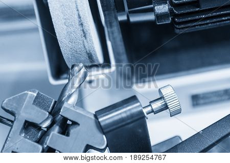 The drilling tool sharpener machine in light blue scene.Tooling production concept.
