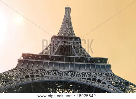 Bottom view on Eiffel Tower in sunlight Paris France