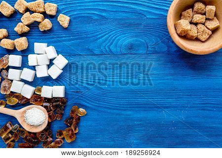 Lumps Of Sugar With Bowls Sweet Set On Blue Table Background Top View Mockup
