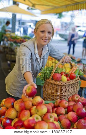 woman on the fruit market with shopping basket