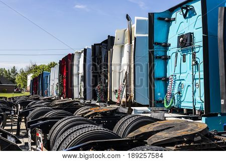 Indianapolis - Circa June 2017: Colorful Semi Tractor Trailer Trucks Lined up for Sale XII