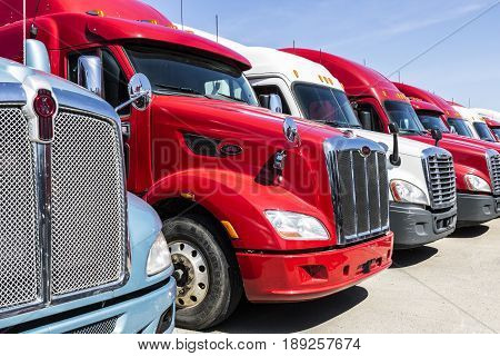 Indianapolis - Circa June 2017: Colorful Semi Tractor Trailer Trucks Lined up for Sale XIV