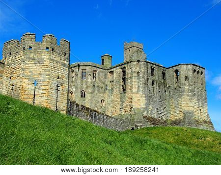 the medieval walkworth castle in northumbria with toes and battlements in summer