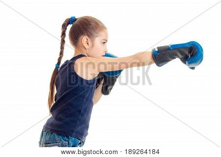 little girl with pigtail stretches forward hand in Boxing Glove isolated on a white background close-up
