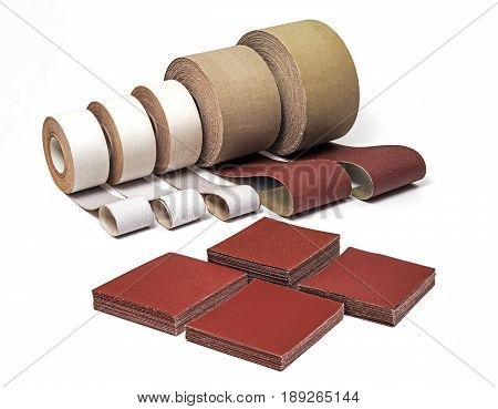 Sandpaper in Rolls and Sheets for Industrial Use in Different Sizes and Thickness on White background