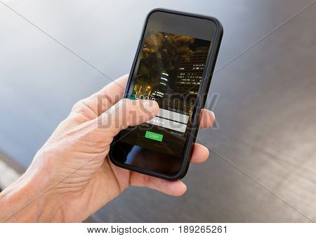 Digital composite of Hand with phone and login screen