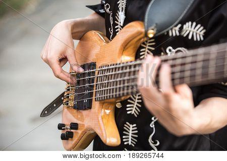 Guitarist plays the guitar. Close-up of hands