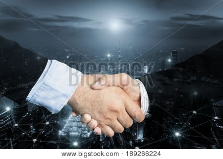 Deal or agreement business concept handshake double exposure coperation or partnership business with internet connection social on line.