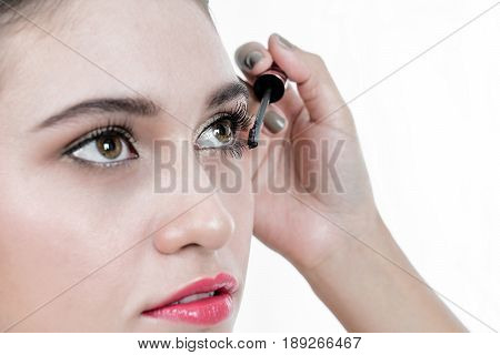 Close-up portrait of Asian beautiful woman Make-up with black eyeliner to her eyelid. Make-up beauty woman concept.