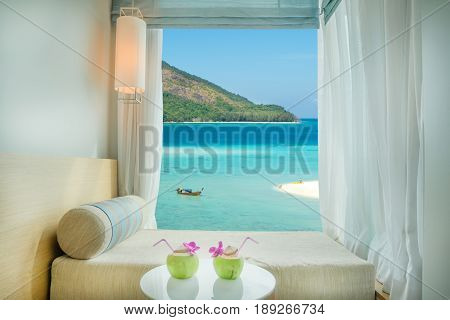 Beautiful Phuket tropical sea view at window in resort Phuket Thailand. Summer Travel Vacation and Holiday concept in Phuket Thailand.
