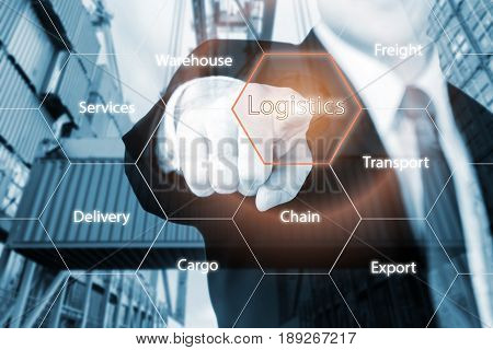 Logistics concept with businessman hand holding digital tablet shipping icons use for import export and logistics background.