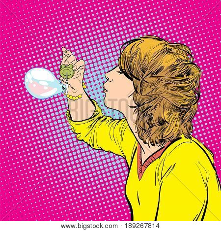 Young girl blowing soap bubbles. Happy time. Funny time