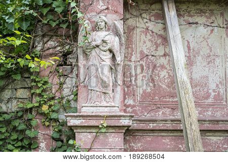 Old Grungy Bold Relief Of An Angel