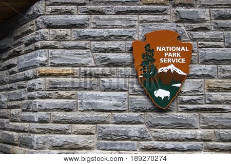 Gatlinburg, Tennessee, USA - May 14, 2017: Insignia for the United States National Park Service on a visitors center in the Great Smoky Mountains National Park.