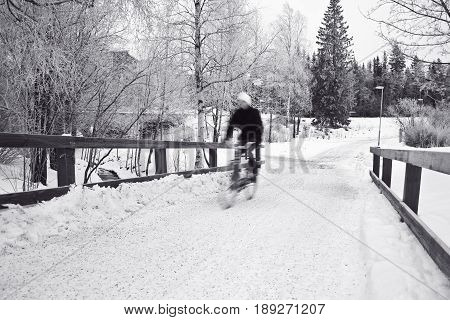 Cyclist trying to master the difficult road without dropping off his bike.