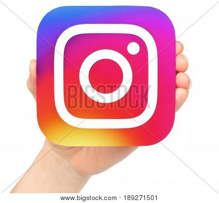 Kiev Ukraine - January 20 2017: Hand holds Instagram icon printed on paper. Instagram is an online mobile photo-sharing video-sharing service