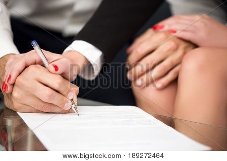 Man singning marriage settlement rich woman pulling into it
