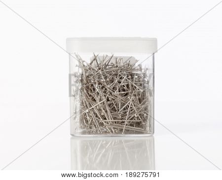 Plastic Box of Small Nails on White