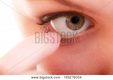 Part of face female eyes. Medicine healthcare human eye pain foreign body.