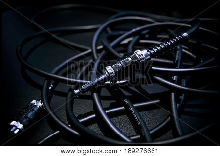 A Bundle of Audio Cables on an Amplifier. Black and White.