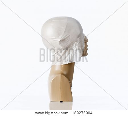 Mannequin Scalp Covered by Plastic As Bald Head