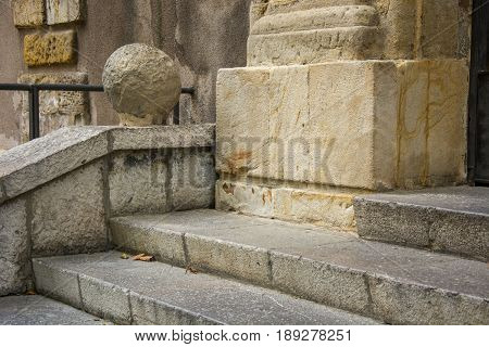 Photo of several steps with stone texture and sunlighht