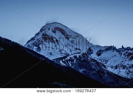 Mountain landscape, beautiful view of Mount Kazbek, high snow slopes, nature of the Caucasus, Georgia